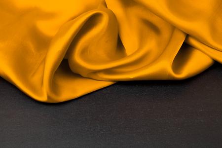 Elegant yellow silk satin fabric background