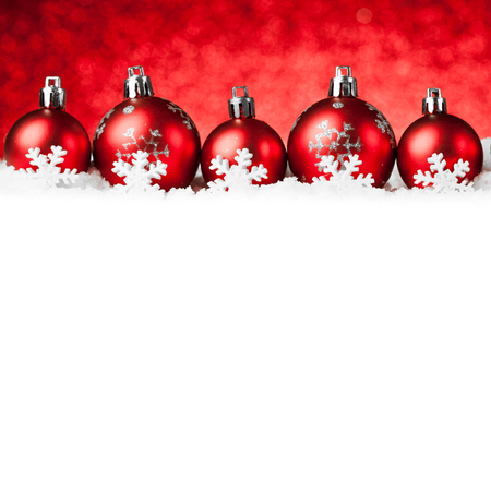 red christmas balls on snow. Stock Photo