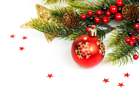 Christmas ball and fir branches with decorations isolated over white 스톡 콘텐츠