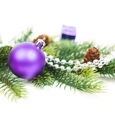 christmas tree purple: Christmas ball and fir branches with decorations isolated over white Stock Photo