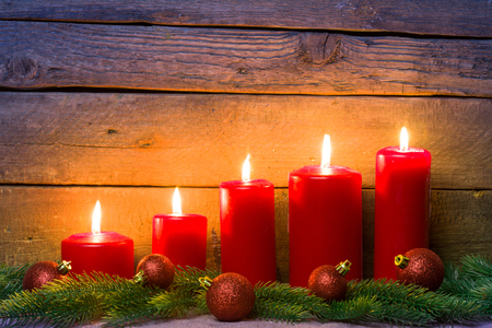 candles: Wooden background with Christmas candles.