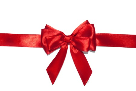 Red ribbon bow on white background. Stock Photo