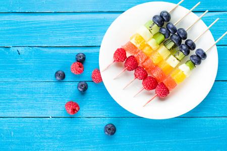 Fresh summer fruits on sticks. Studio shot