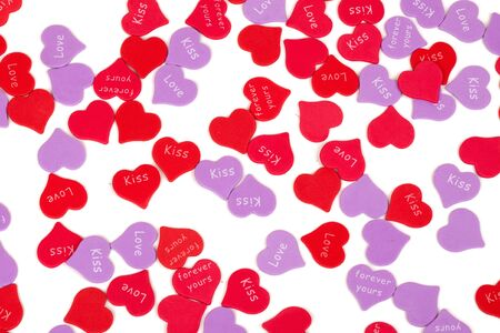 scattered in heart shaped: Valentines Day confetti on white background. Studio shot