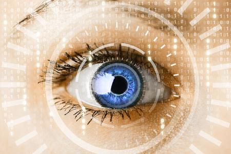 binary: Modern cyber woman with matrix eye concept. Macro shot Stock Photo