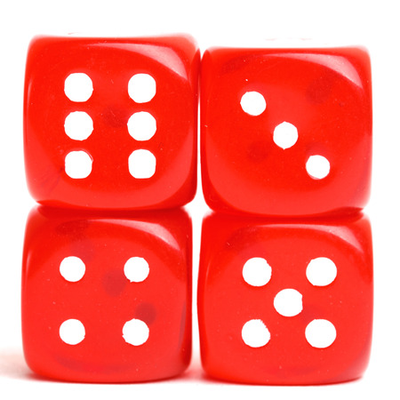 rolling dice: rolling red dice isolated on white.