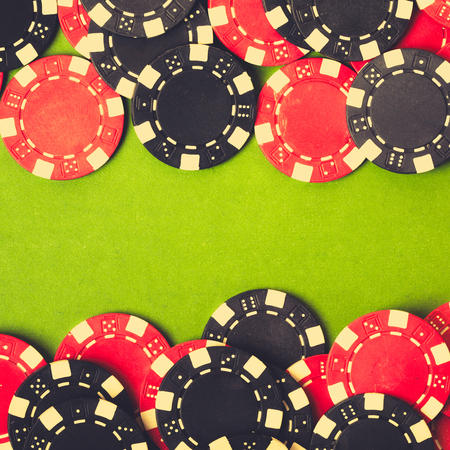 texas hold em: Red and black gambling chips. vintage background