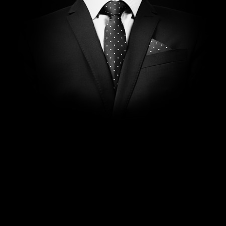 man in suit on a black background. studio shot