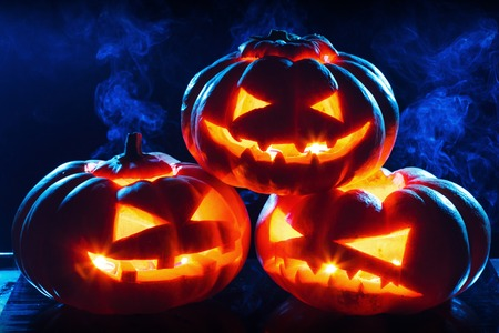 Halloween pumpkin head jack lantern with scary evil faces spooky holiday Stock Photo