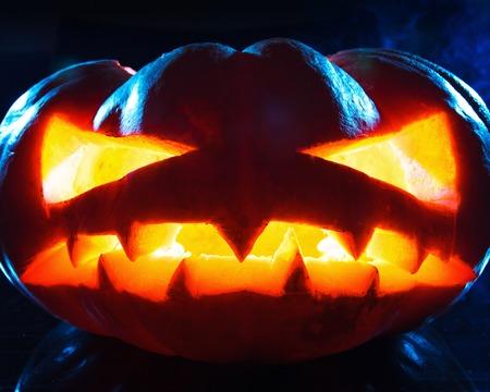 hollows: Halloween - old jack-o-lantern on black background. Studio shot Stock Photo
