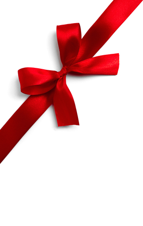 goodie: Red ribbon bow on white background. studio shot Stock Photo