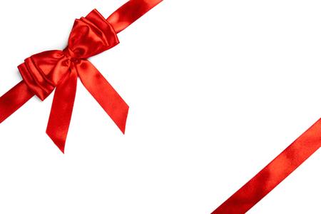 Red ribbon bow isolated on white background. Studio shot Stock Photo