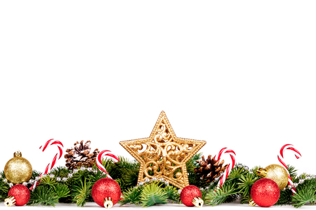 Christmas Border - tree branches with golden balls, candy and big star isolated on white, horizontal banner 版權商用圖片