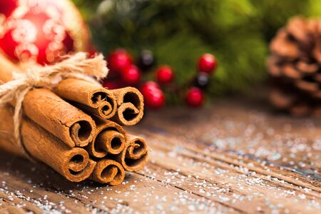 Bunch of cinnamon sticks on wooden table. Christmas time
