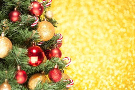 decorated tree: Gold Christmas background of de-focused lights with decorated tree