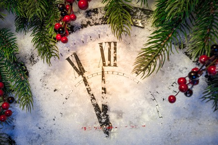 Christmas clock and decoration on snow. Happy new year concept Stock Photo