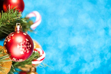 Christmas tree and baubles on blue background Stock Photo