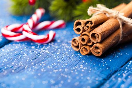Bunch of cinnamon sticks on wooden table. Christmas time