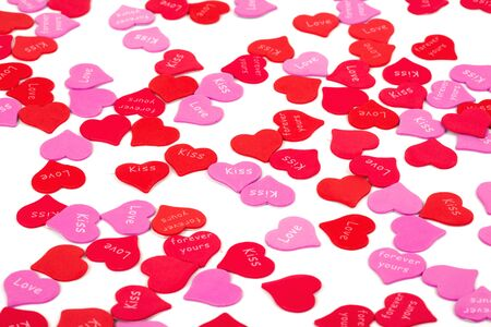 scattered in heart shaped: Valentines Day confetti on white background