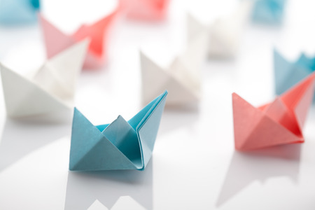 Leadership concept using paper ship