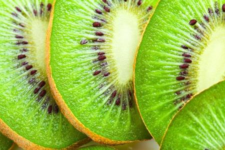 Kiwi slices as background. Studio macro shot Stock Photo
