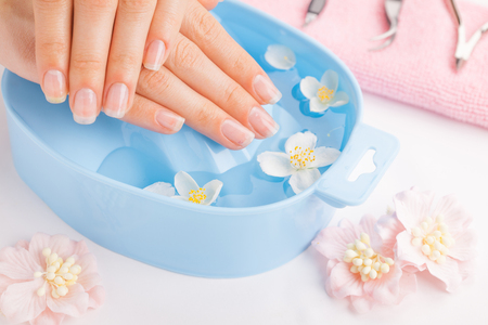 woman in bath: Spa treatment and product for female hand spa Stock Photo