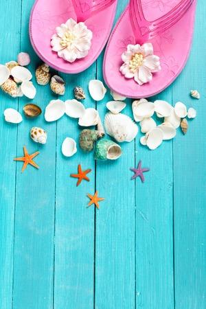 Pink flip flops and seashells