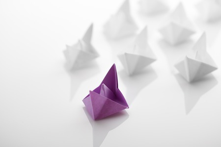 Paper boats on white background