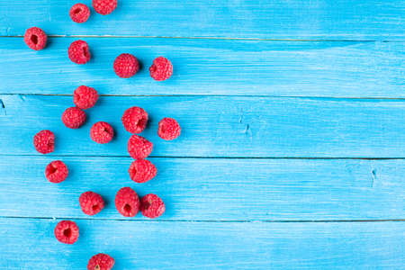 Fresh raspberries on a rustic wooden table