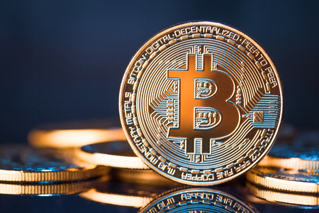Golden Bitcoins on a blue background