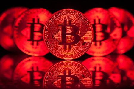 Five Virtual Coins Bitcoins On Printed Circuit Board. Stock Photo