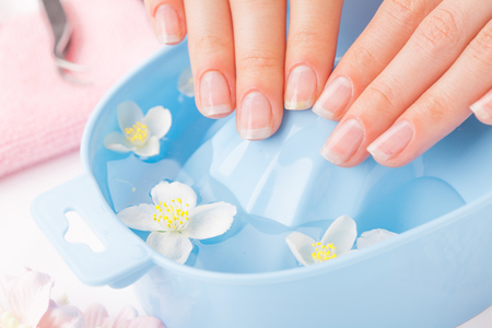 Womans nails with beautiful french manicure