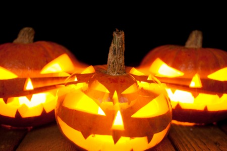 Halloween pumpkin head jack lantern on dark background Stock Photo