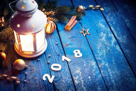 Burning lantern and christmas decoration Stock Photo