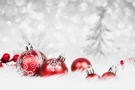 Christmas red balls with silver decoration on the snow 스톡 콘텐츠