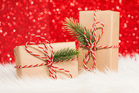 two gift boxes on red glitter background Stock Photo