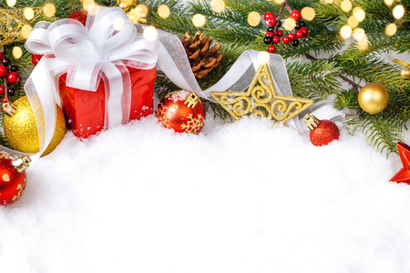 Christmas presents in red boxes at snow Stock Photo