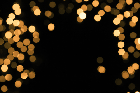 Abstract gold sparkle on dark background