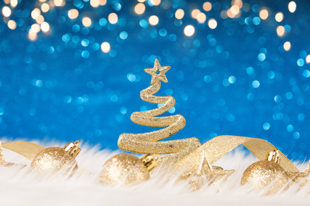 Christmas decoration on the blue glitter background. New year greeting card template
