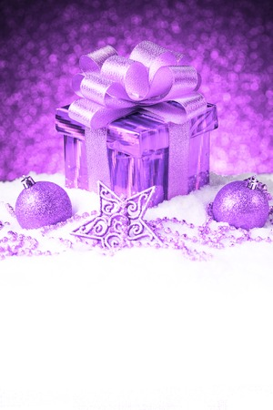 Christmas present with decoration on snow Stock Photo