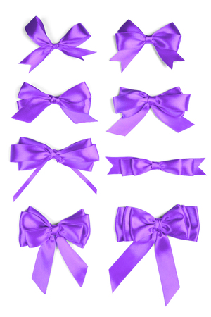 Shiny purple satin ribbon on white background Stock Photo