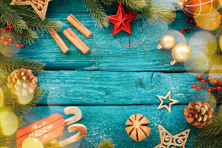 Christmas border with decoration on a wooden board