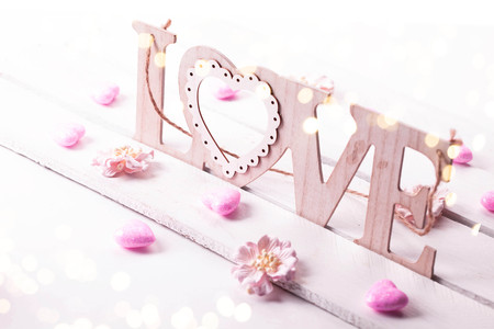 Valentines Day background with wooden word love