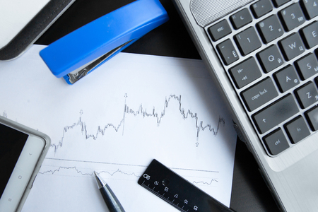 Financial graphs on office table