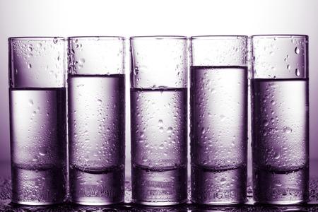 row of glasses for vodka Stock Photo