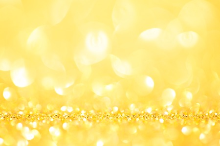 Abstract shining glitters gold holiday bokeh background Stock Photo