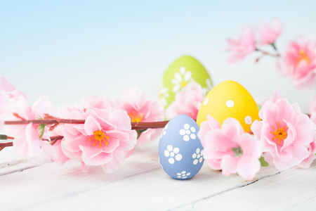 Easter eggs on blue wooden background