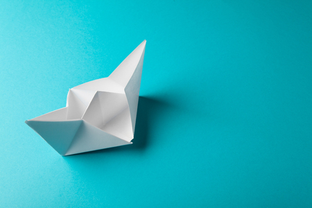 boat paper origami on the blue background