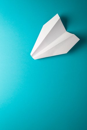 paper airplane on blue background