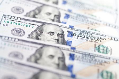 Row of one hundred US dollar bills